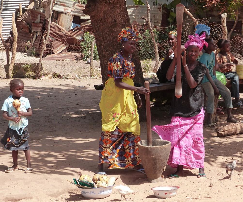 Women pounding cassava