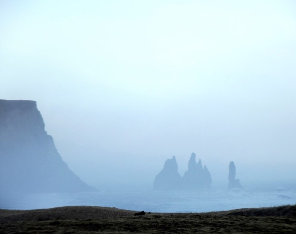 Misty view of cliffs and rocks