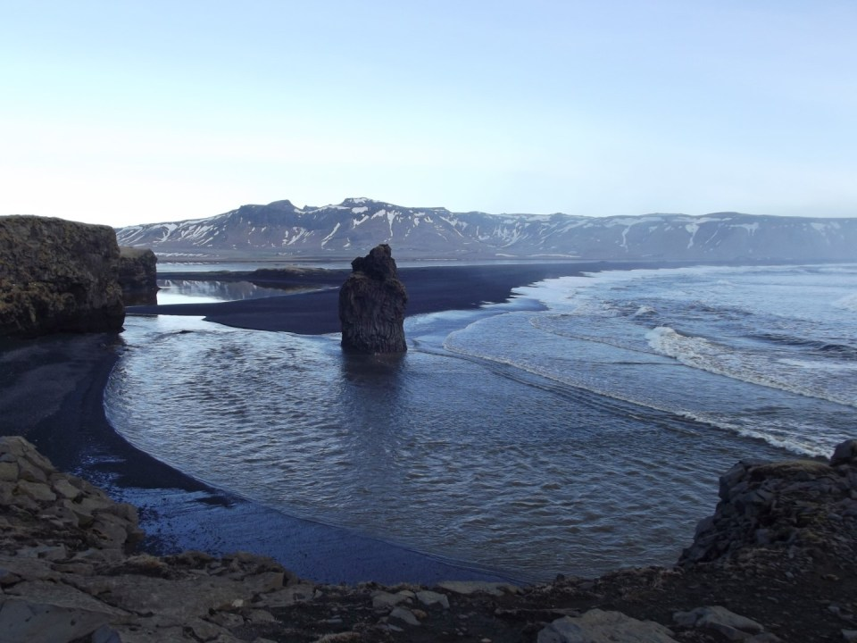 View from cliffs of black sand beach