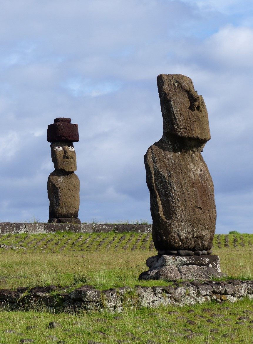 Two moai, one with restored eyes