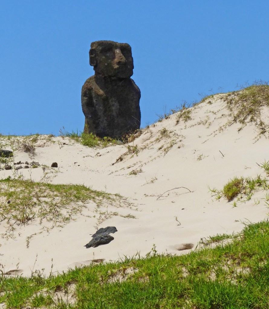 Moai among sand dunes
