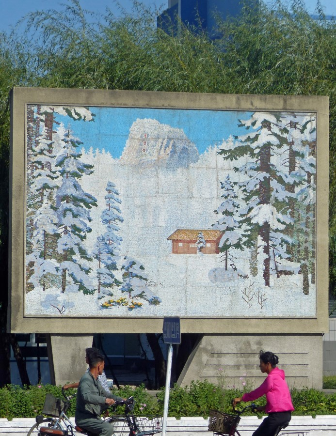Large mosaic of snow scene with hut
