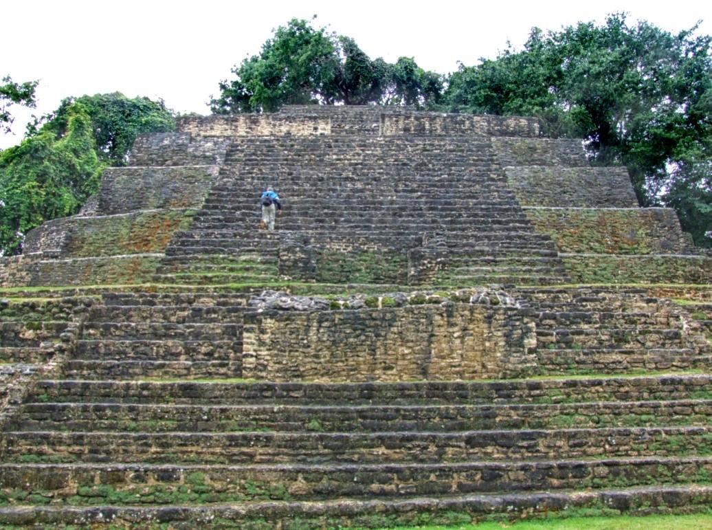 Man climbing steps of Mayan temple