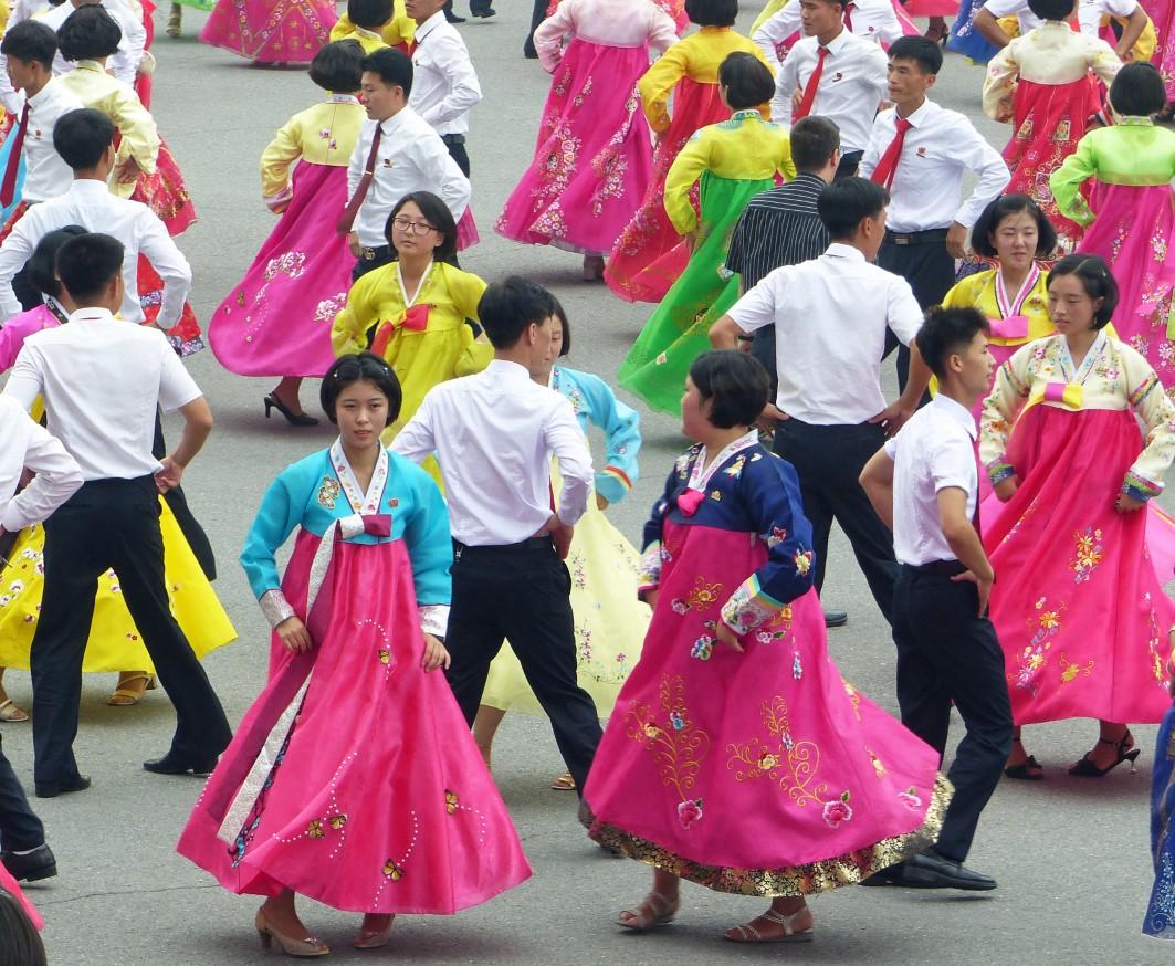 Women and men dancing in traditional Korean dress