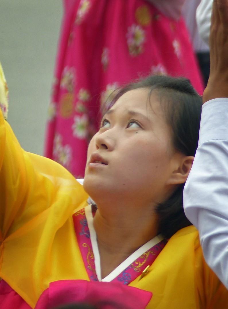 Woman dancing in traditional Korean yellow dress