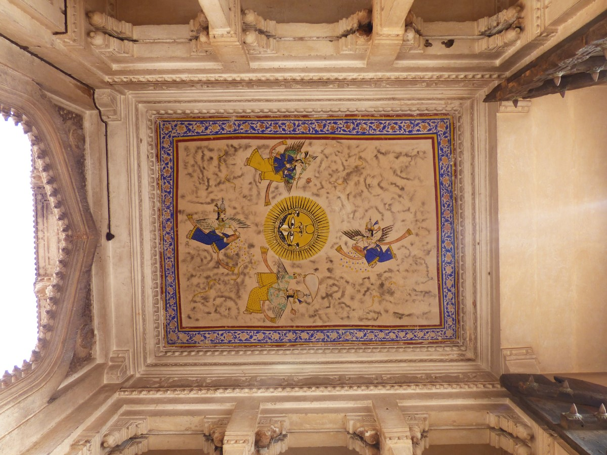Painted ceiling with sun at centre