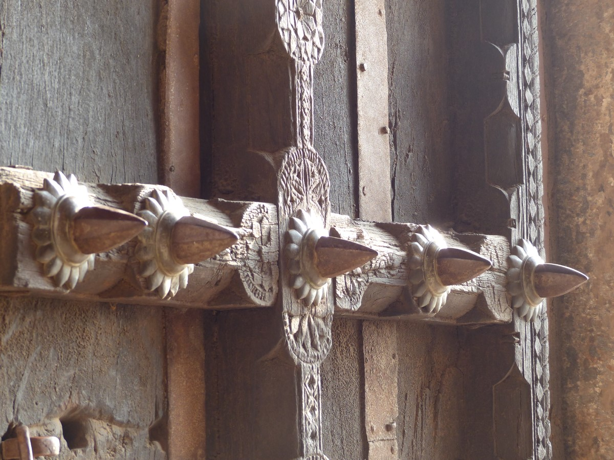 Heavy wooden door with spikes
