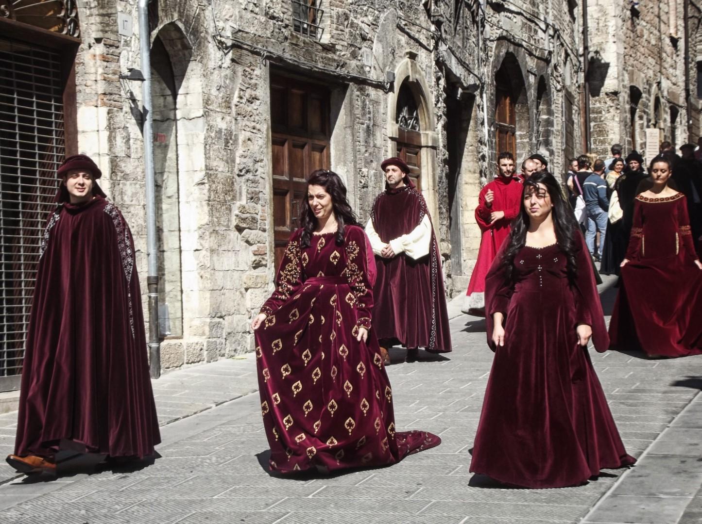Ladies in dark velvet dresses