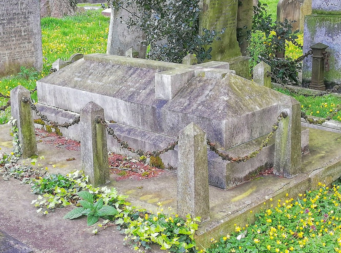 Carved chest tomb
