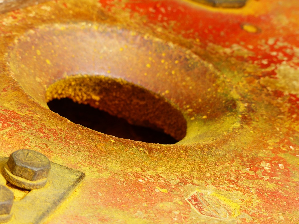 Bright orange metal machine with a hole