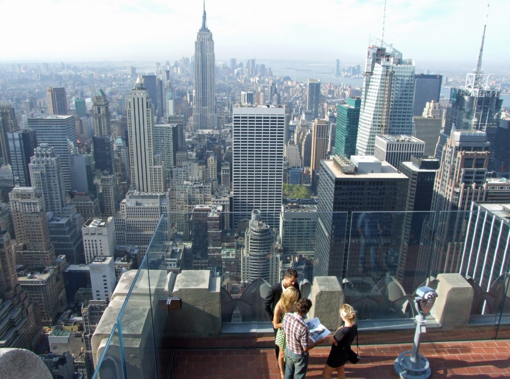 View of New York with people on roof terrace