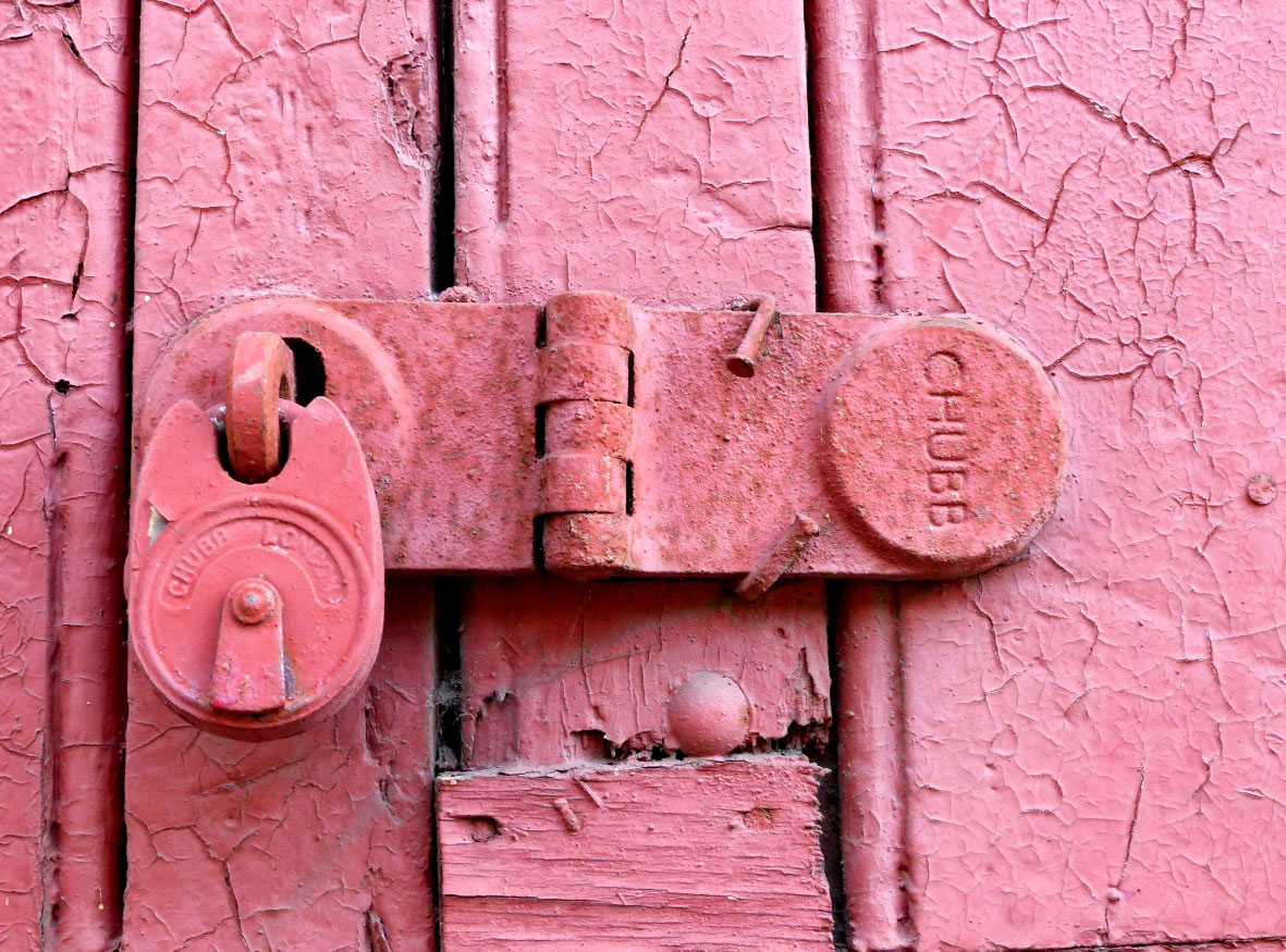Pink lock on a pink door