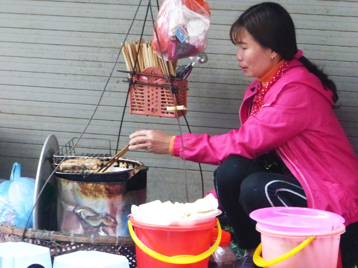 Lady cooking on a grill