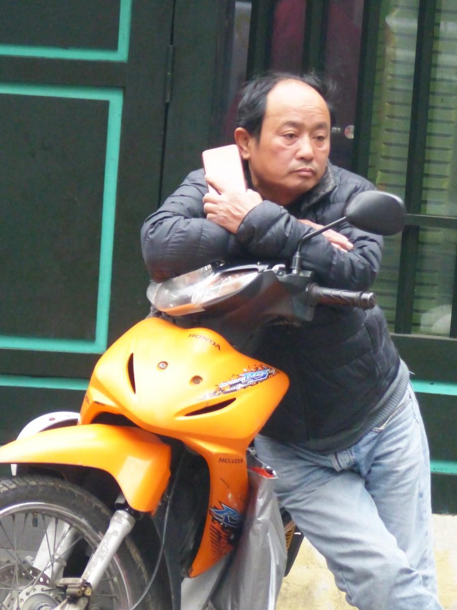 Man leaning on motorbike