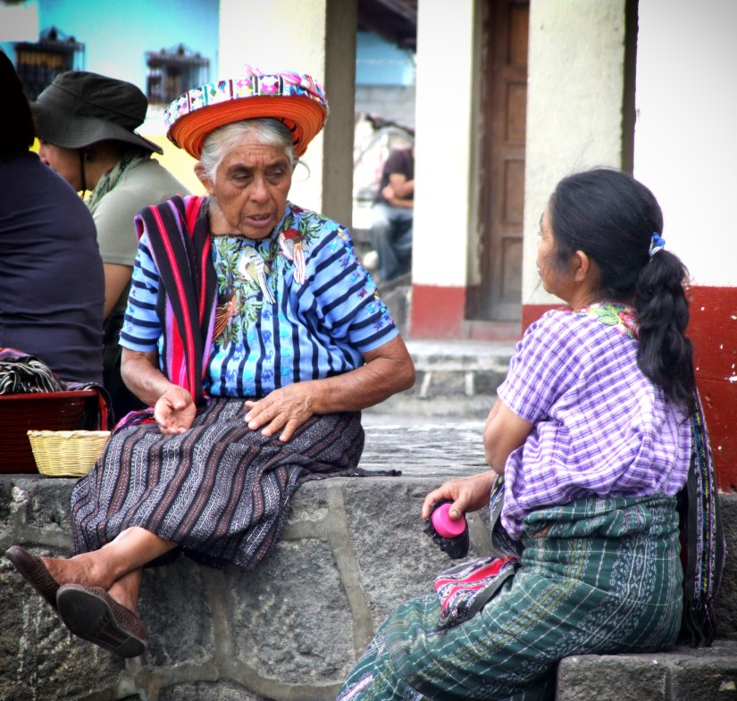 Two women wearing traditional dress
