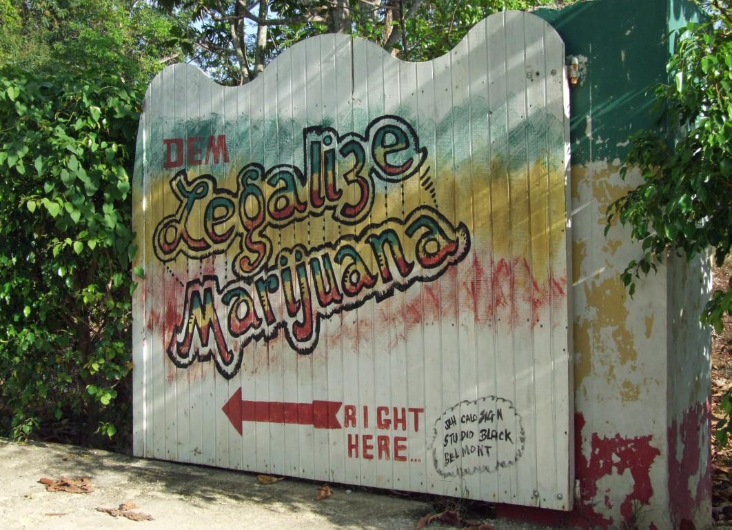 Gate with 'Legalise Marijuana' sign