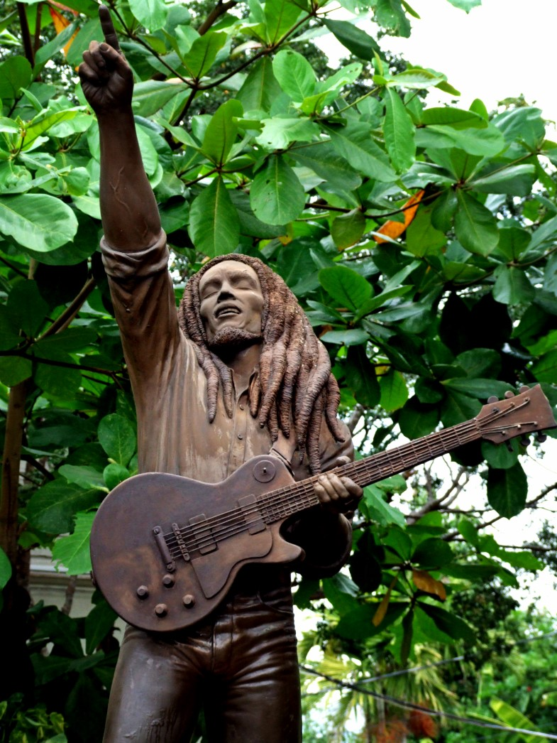 Statue of man with dreadlocks and a guitar