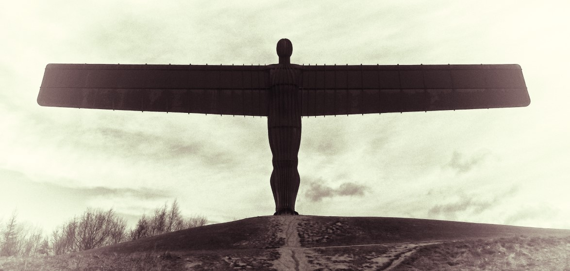 Huge sculpture with outspread wings