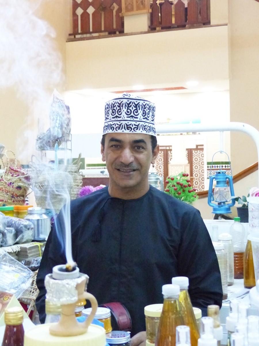 Man selling incense burners