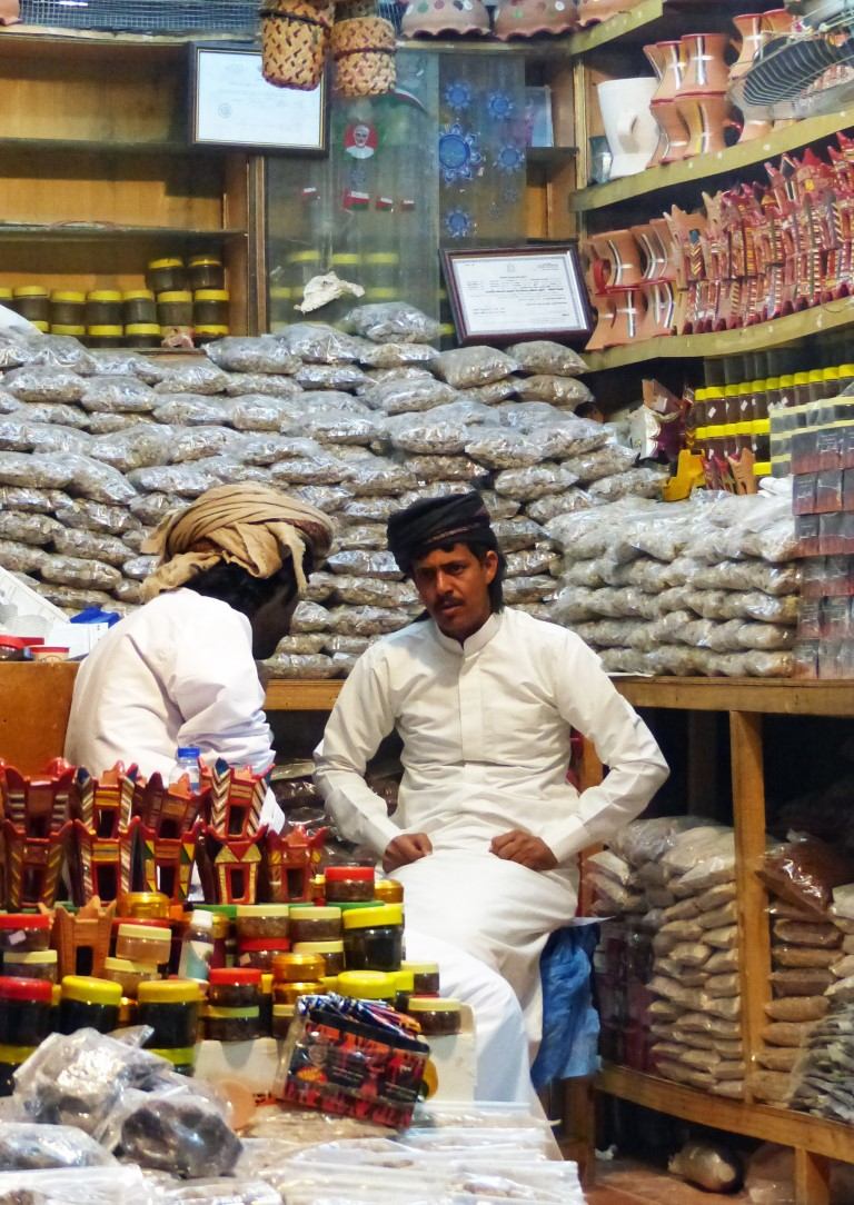 Two men in shop selling frankincense and burners
