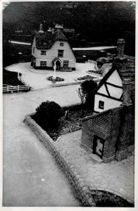 Black and white photo of houses in a model village