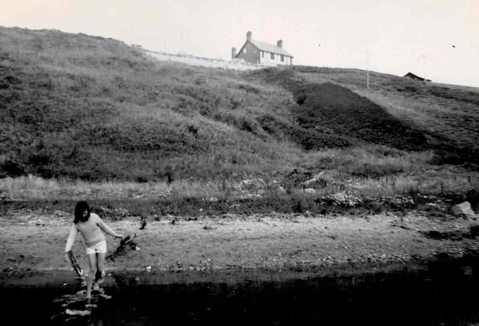 Black and white photo of girl paddling