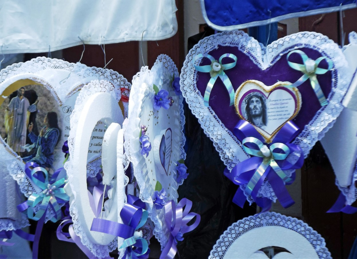 White hearts with purple trim and religious images