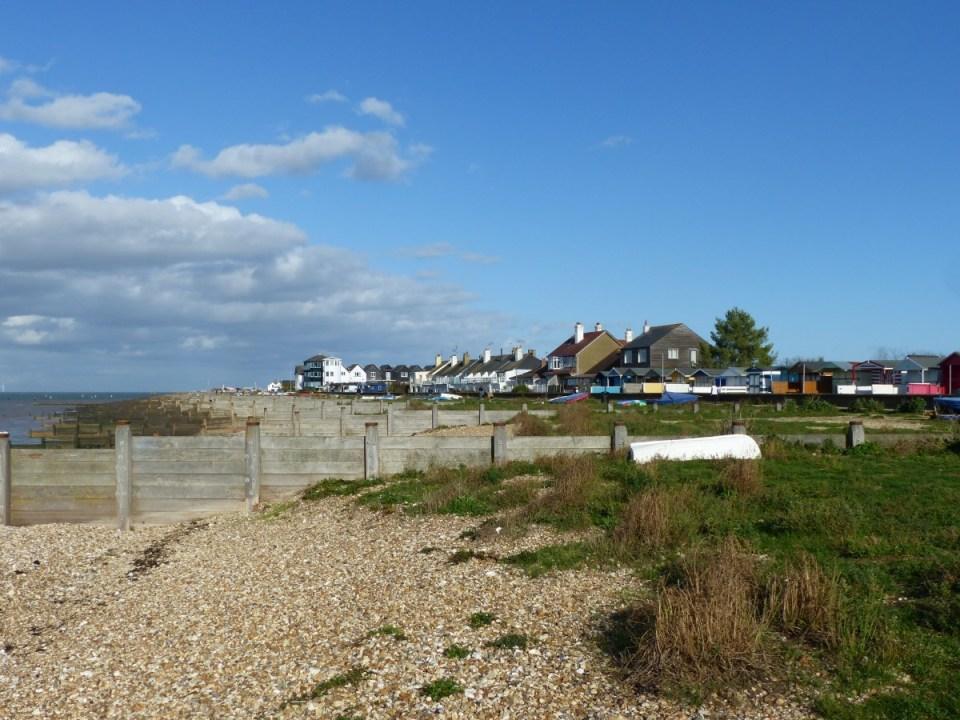 Pebble beach with houses beyond