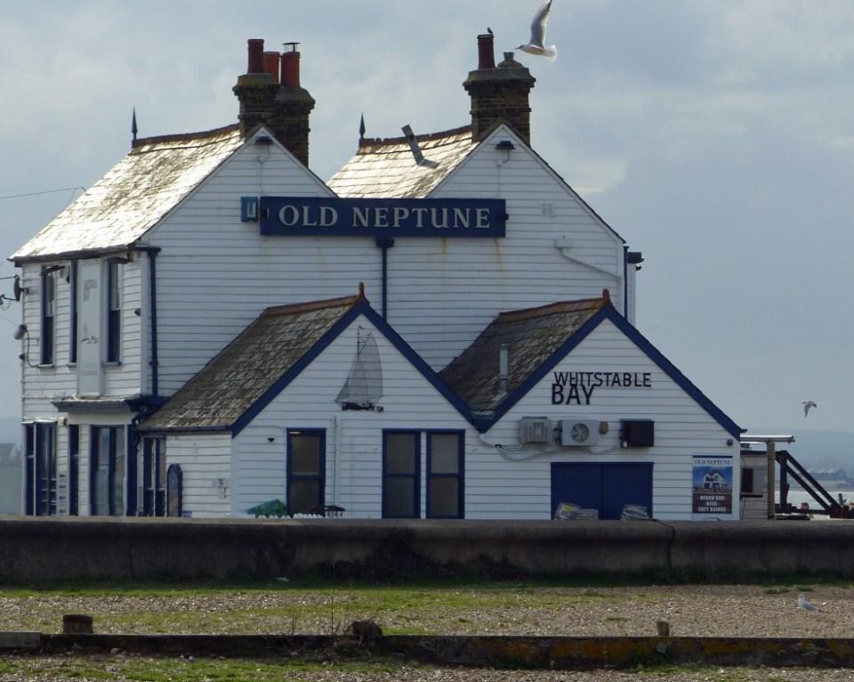 White pub on a pebble beach