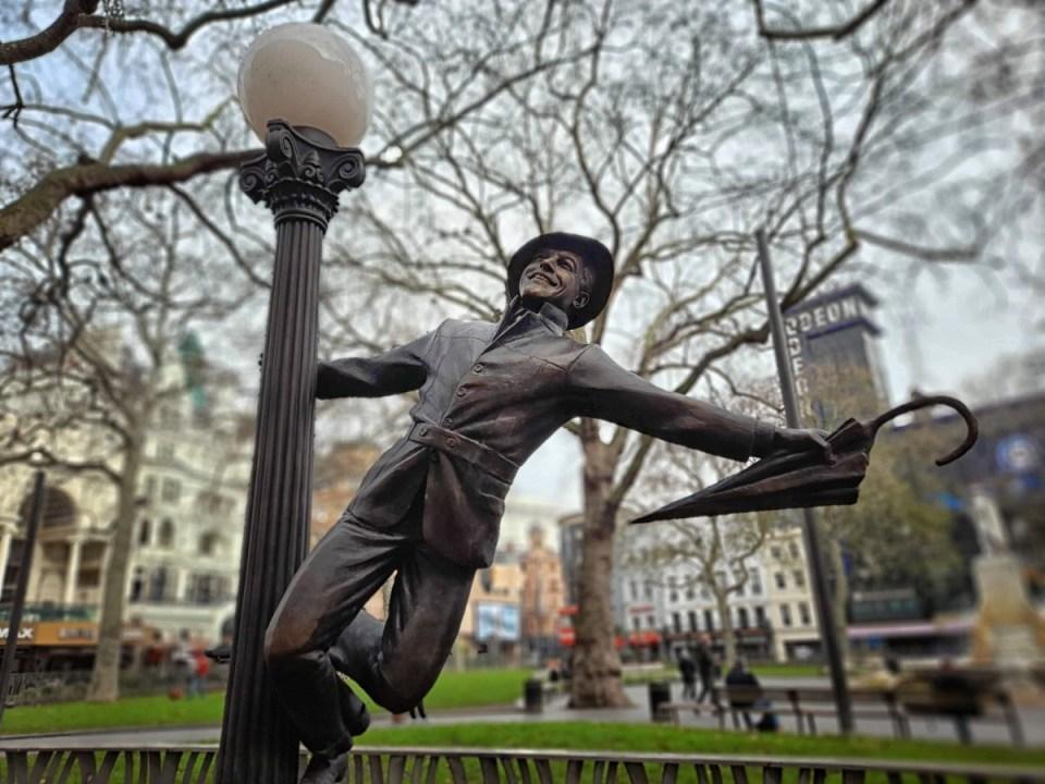 Statue of man with umbrella