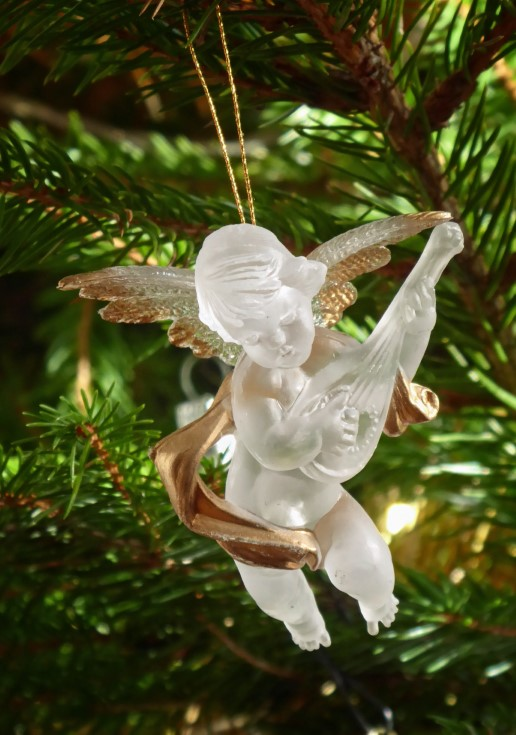 Glass angel in a Christmas tree