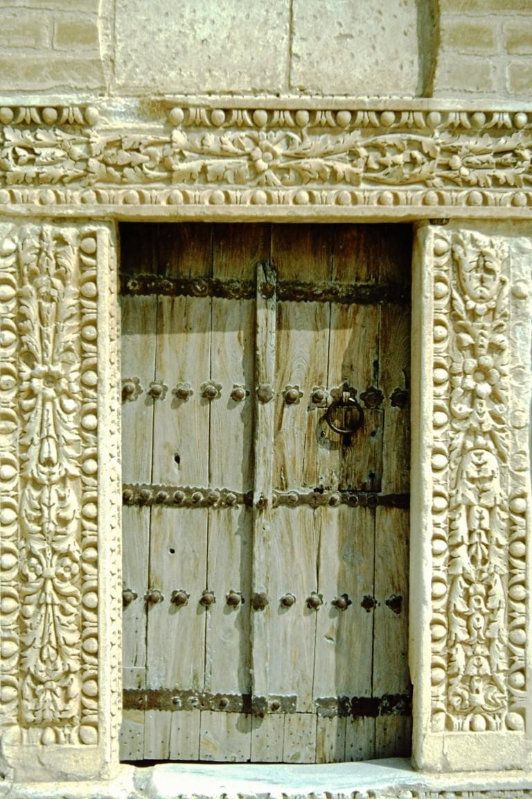 Carved stone doorway and wooden door