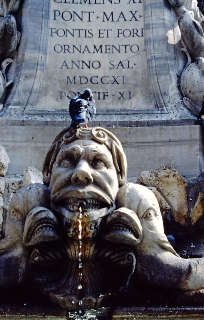 Detail of stone fountain with pigeon