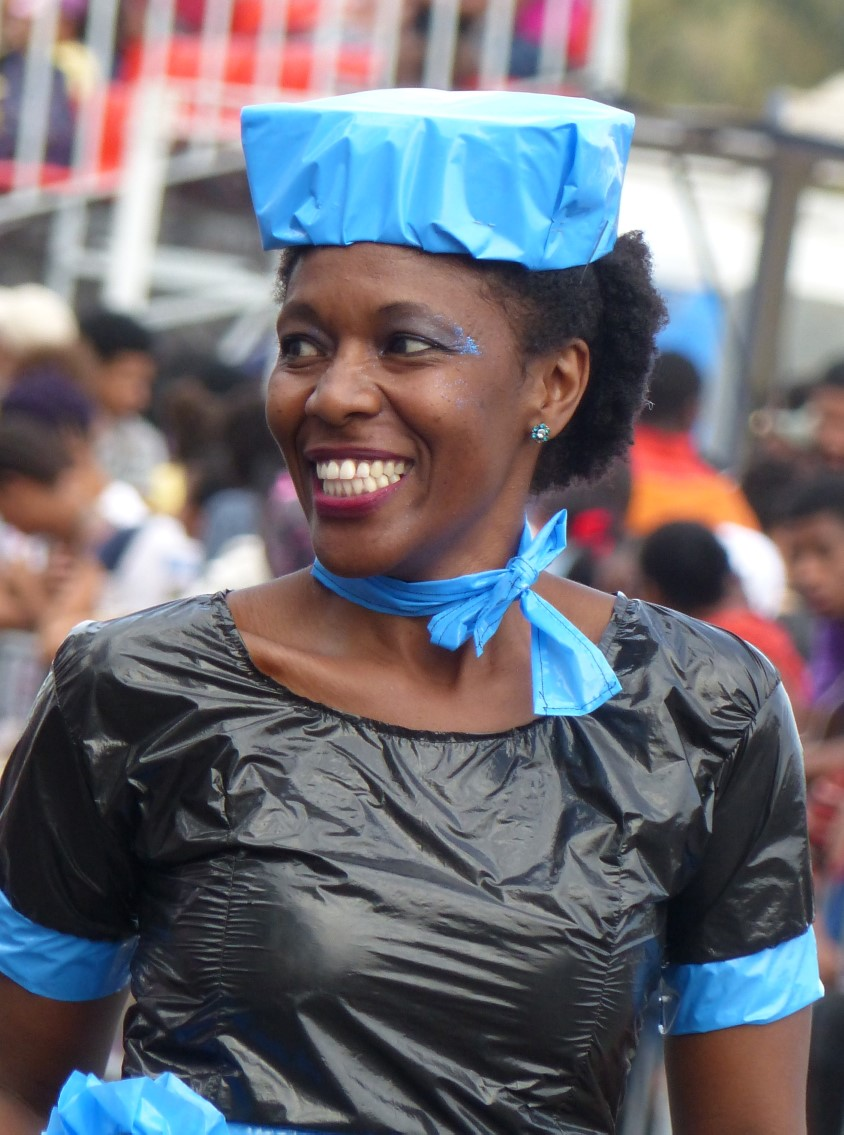 Woman in blue hat smiling
