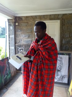 Man wrapped in a red blanket