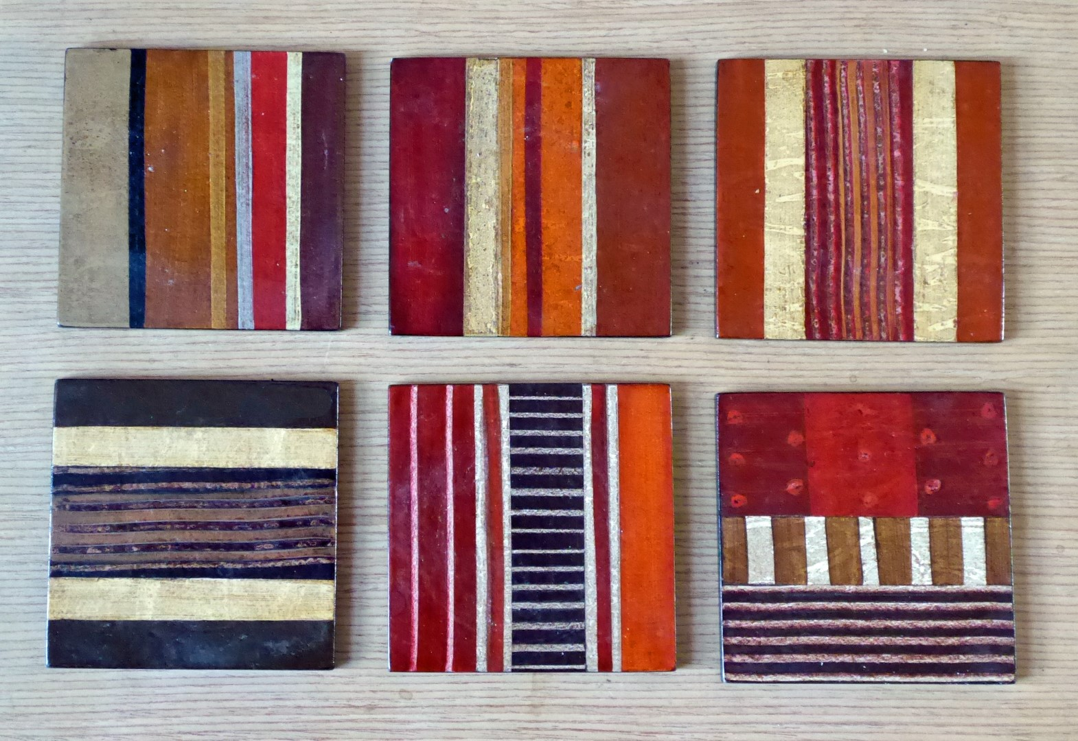 Six wooden striped coasters