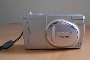 Silver camera with Olympus logo