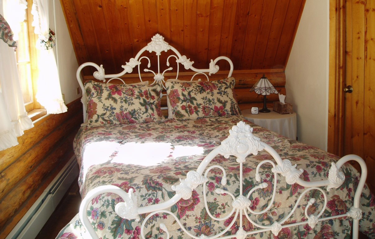Metal frame bed with flowery quilt
