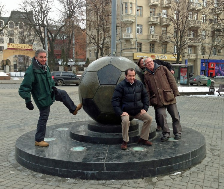 Large metal ball and group of men