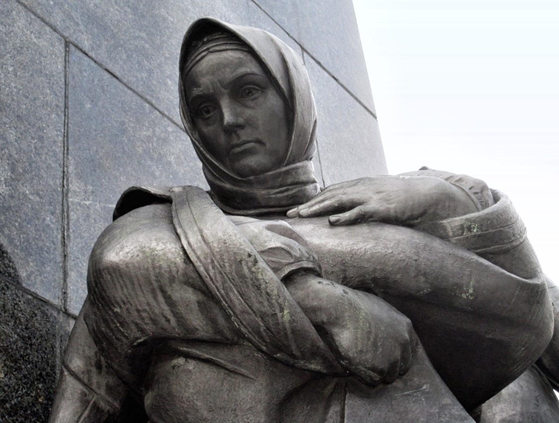 Statue of a woman in a shawl