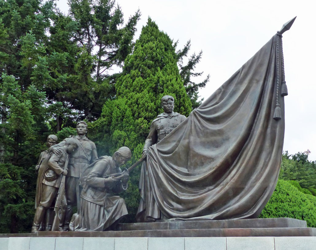 Group of bronze statues with drooping flag