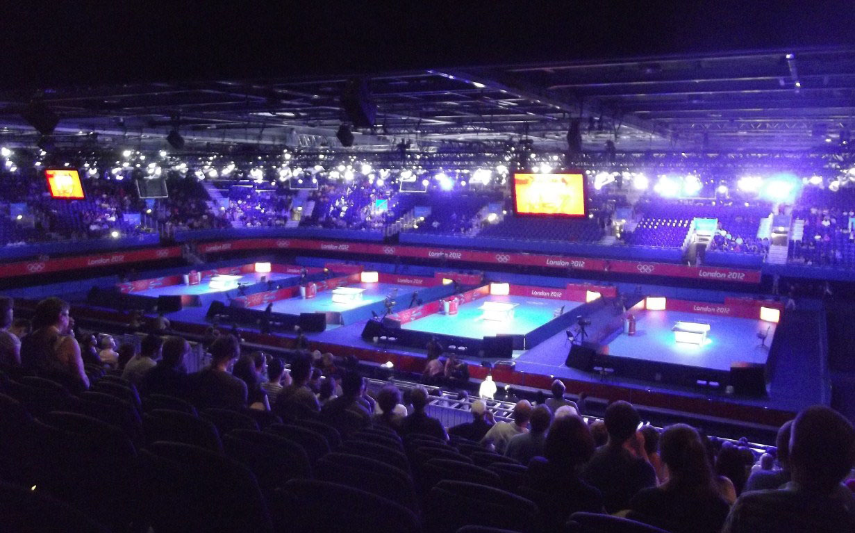 View of arena with four table tennis tables
