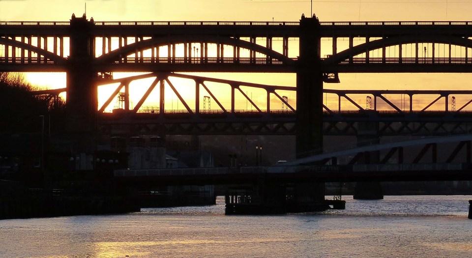 Silhouette of bridges against the sunset