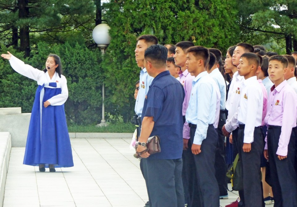 School boys and guide in traditional Korean dress