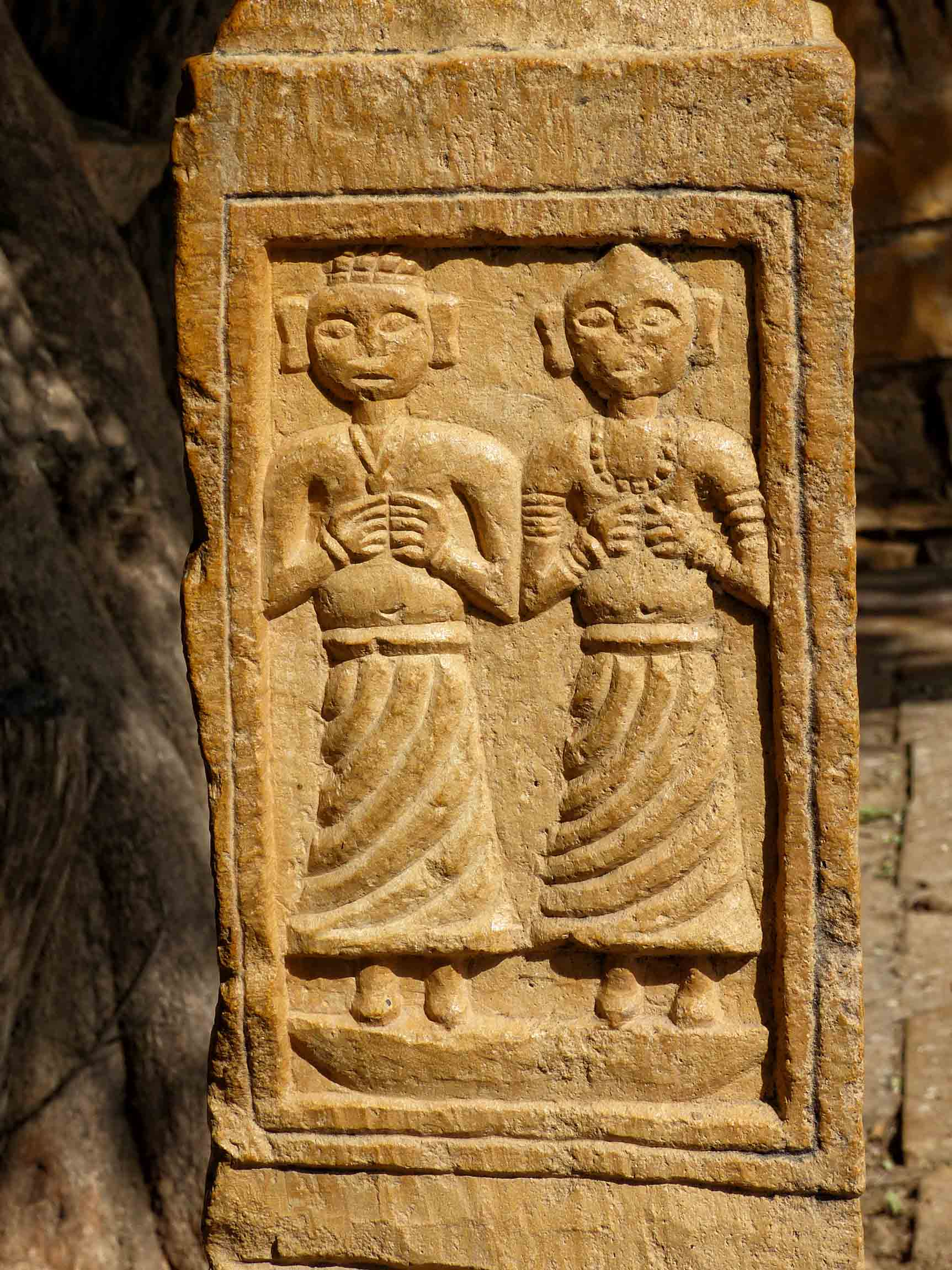 Stone with carving of two women