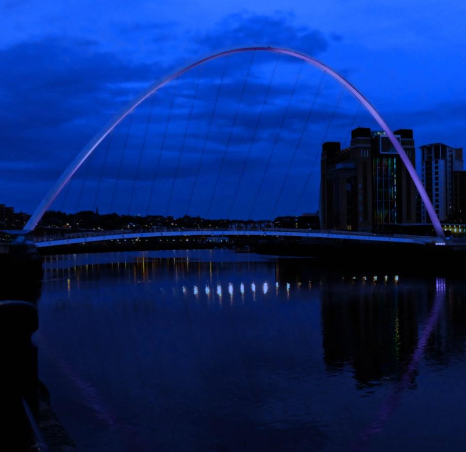 Night scene of a bridge over a river