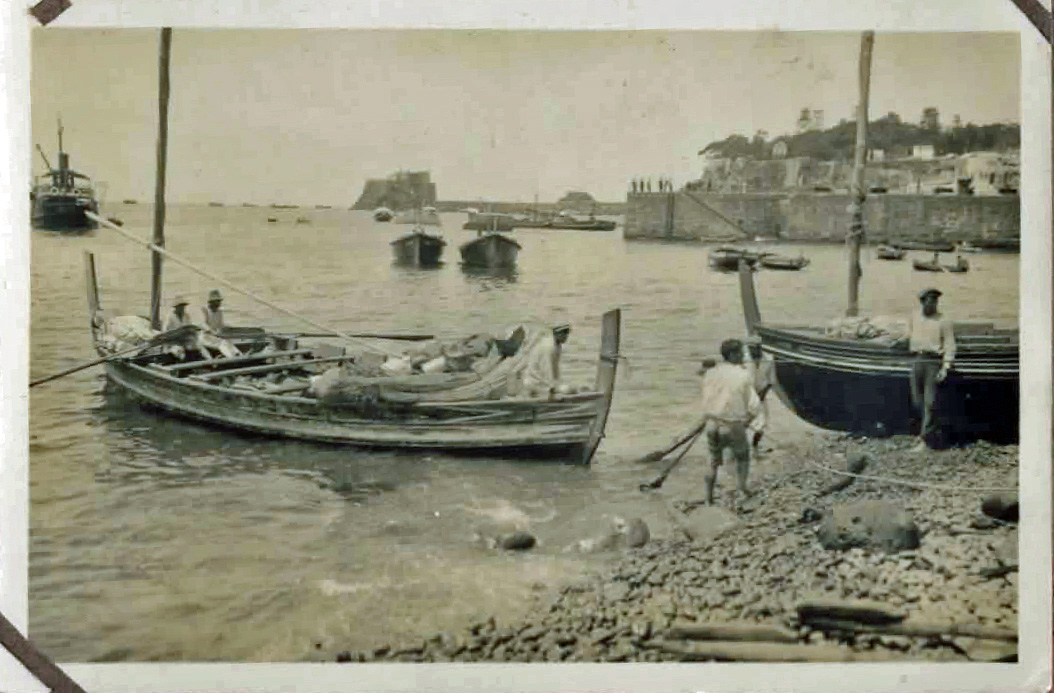 Old photo of boats by the shore