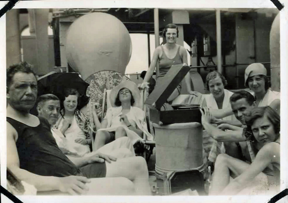 Old photo of people in swimwear with record player
