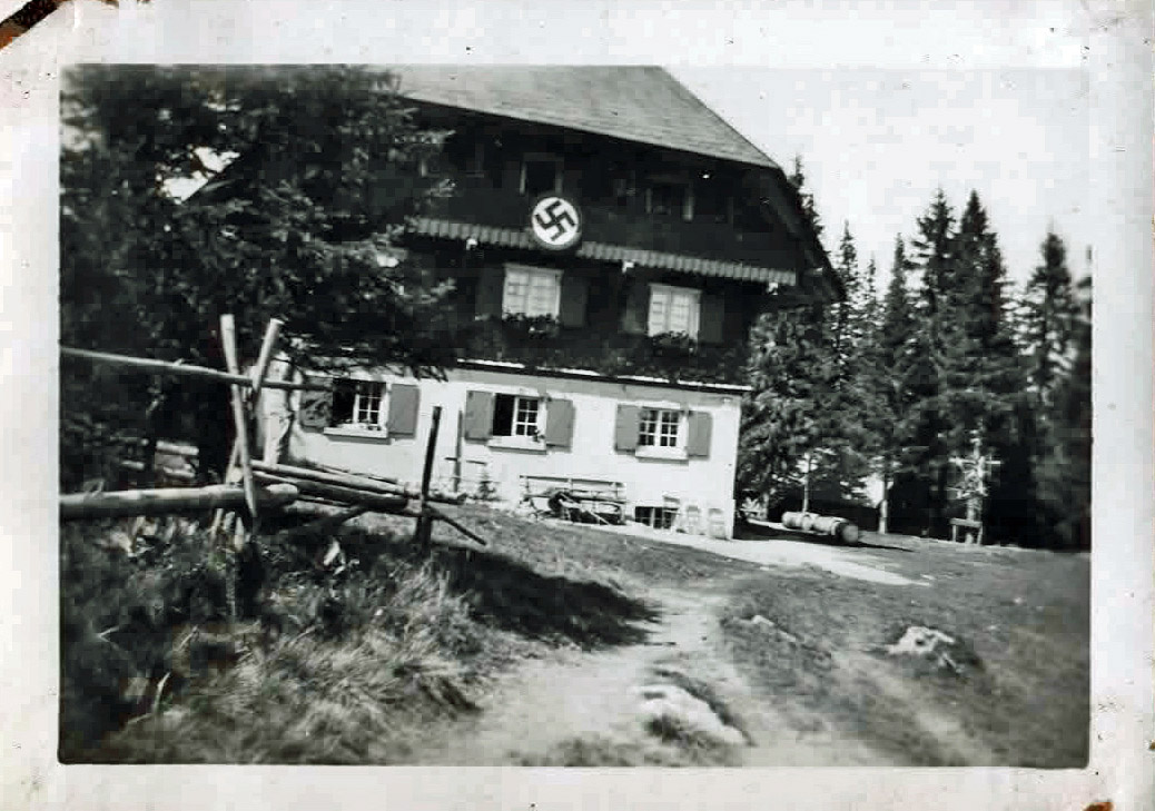 Old photo of alpine house with swastika sign