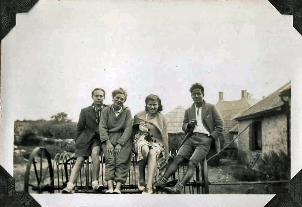 Old photo of two men and two women